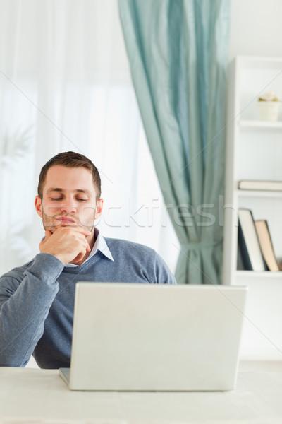 Genç işadamı düşünme iş bilgisayar ev Stok fotoğraf © wavebreak_media