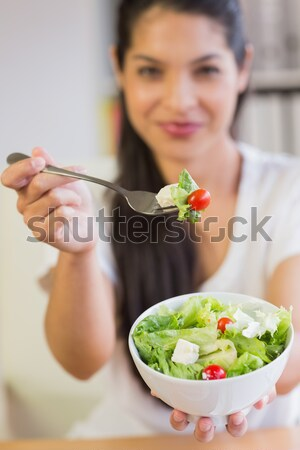 Salad offered by happy smiling woman against a white background Stock photo © wavebreak_media