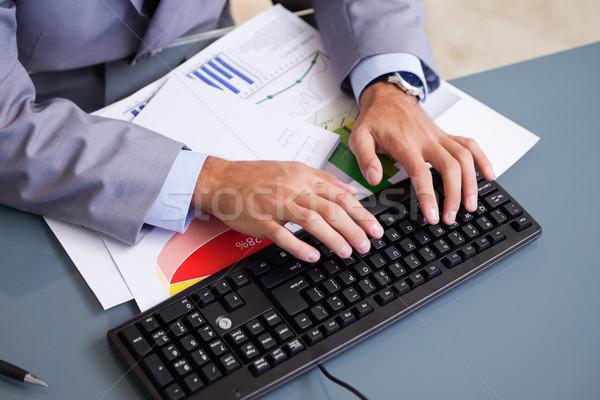 Male hands typing on keyboard Stock photo © wavebreak_media