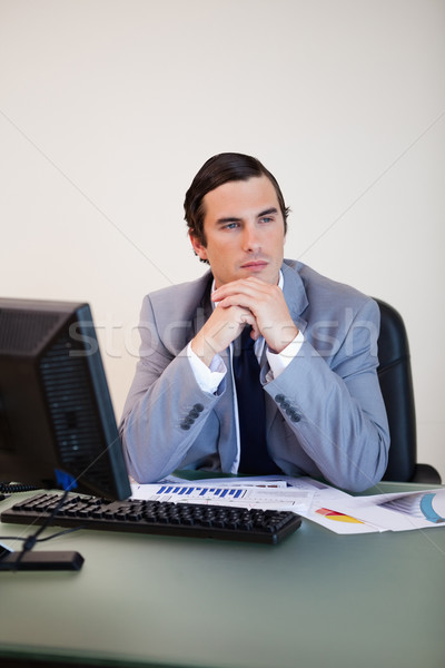 Stock photo: Businessman with hands folded in thoughts