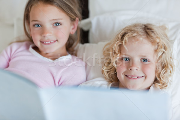 Siblings enjoy reading bed time story together Stock photo © wavebreak_media