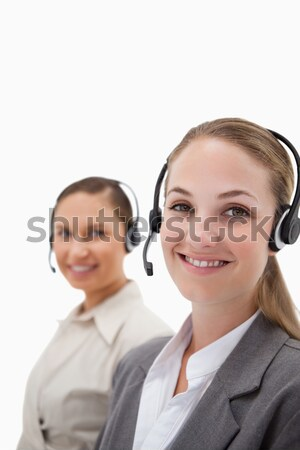Stock photo: Beautiful operators with headsets against a white background
