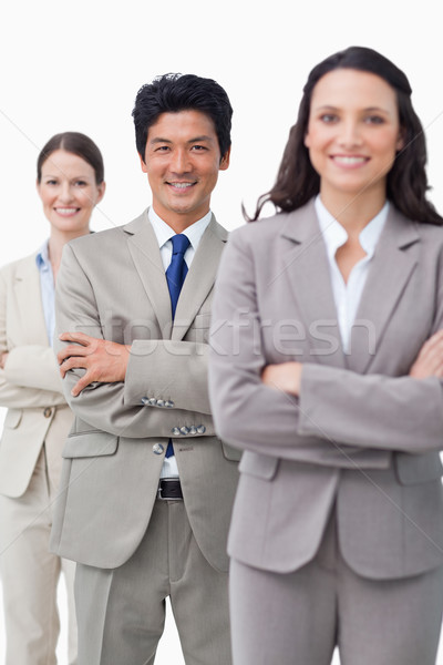 Smiling businessteam standing with folded arms against a white background Stock photo © wavebreak_media