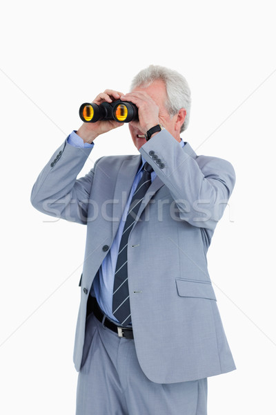 Mature tradesman looking through spy glass against a white background Stock photo © wavebreak_media