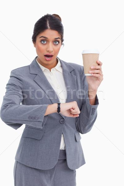 Conmocionado femenino papel taza tiempo Foto stock © wavebreak_media