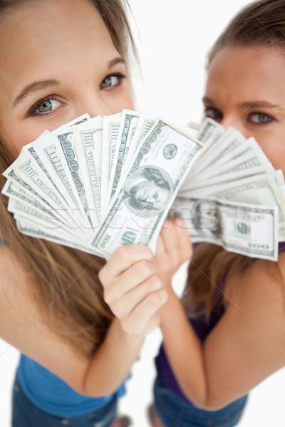 Photo stock: Vue · deux · jeune · femme · derrière · dollars · blanche