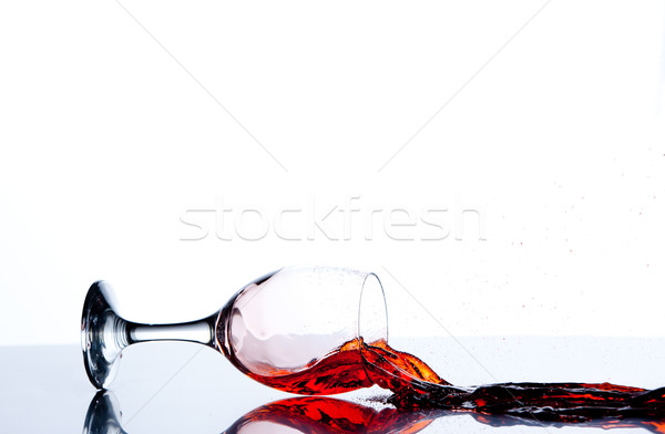 Glass on the floor with a red trickle flowing against a white background Stock photo © wavebreak_media