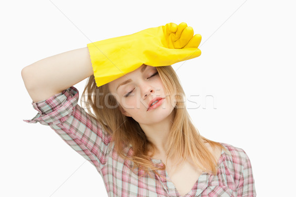 Woman wearing cleaning gloves while wiping her brow Stock photo © wavebreak_media