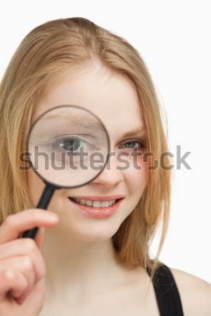 Mosolygó nő nagyító fehér szem női néz Stock fotó © wavebreak_media