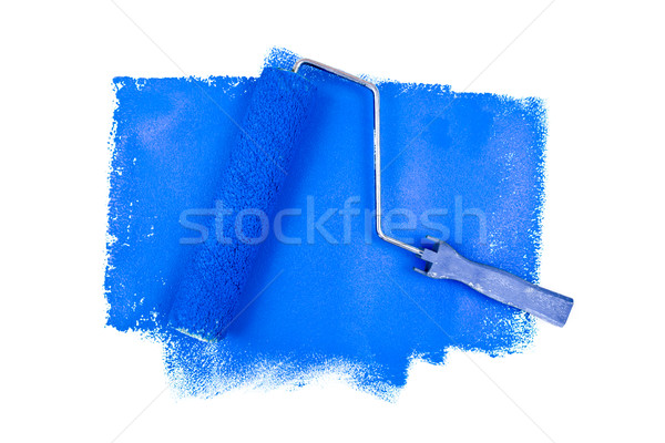 Paint roller on blue traces against a white background Stock photo © wavebreak_media