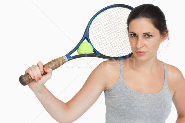 Sportswoman with a tennis racket against white background Stock photo © wavebreak_media