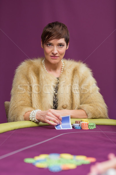 Angry woman at poker table in casino Stock photo © wavebreak_media