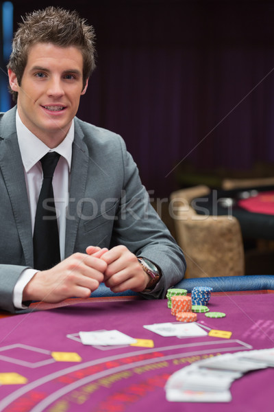 Man sitting at the casino table smiling  Stock photo © wavebreak_media