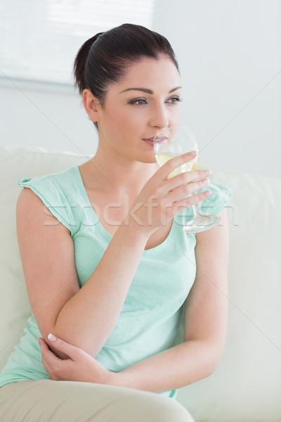 Stok fotoğraf: Kadın · oturma · kanepe · oturma · odası · cam