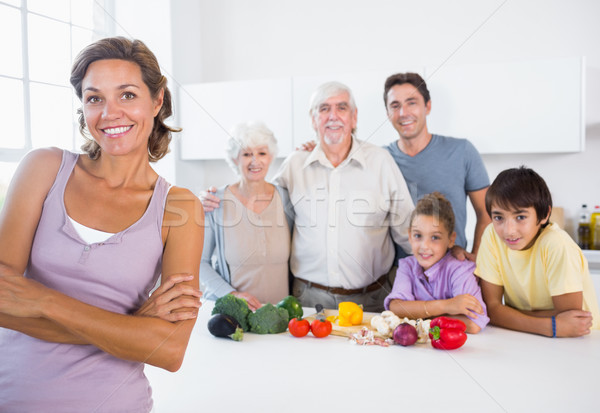 Stock photo: Mother standing beside kitchen counter