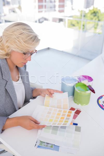 Focus interior designer looking at colour charts  Stock photo © wavebreak_media