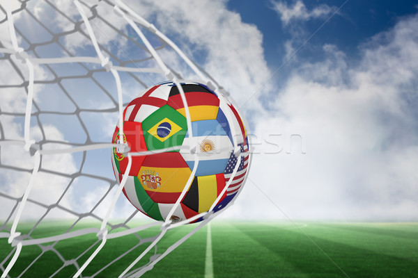 Football in multi national colours at back of net Stock photo © wavebreak_media