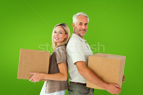 összetett kép boldog pár tart költözködő dobozok Stock fotó © wavebreak_media
