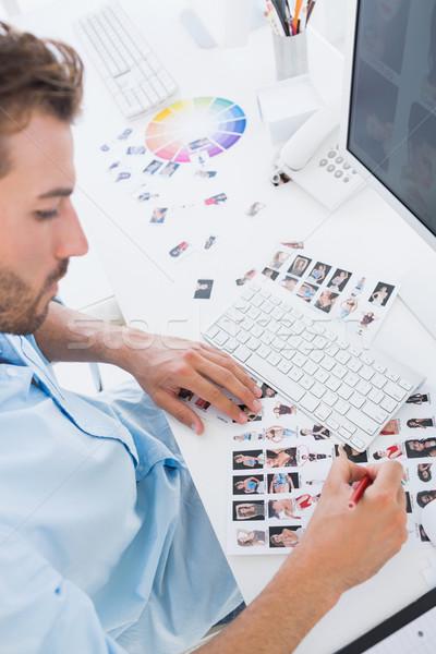 Male photo editor at work in the office Stock photo © wavebreak_media