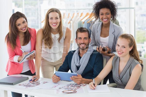 Fashion designers discussing designs Stock photo © wavebreak_media