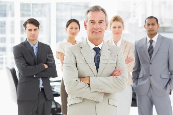 Diverso equipo de negocios sonriendo cámara oficina negocios Foto stock © wavebreak_media