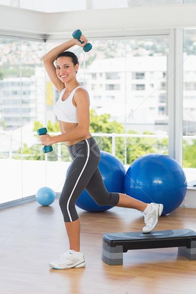Caber mulher jovem passo aeróbica exercer Foto stock © wavebreak_media