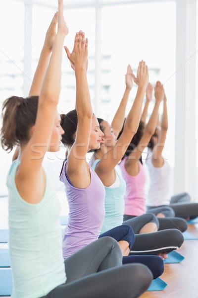 Mulheres meditação pose vista lateral Foto stock © wavebreak_media