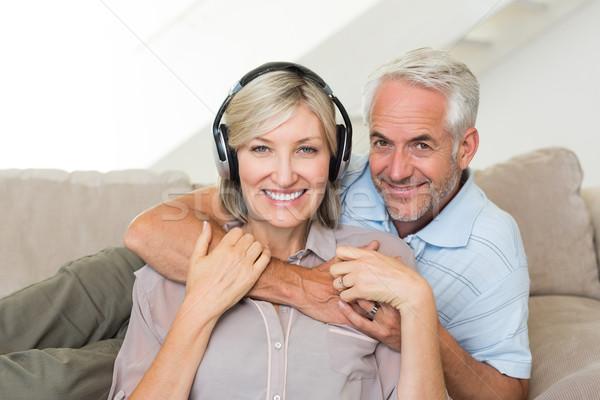 зрелый человек женщину за диван улыбаясь Сток-фото © wavebreak_media