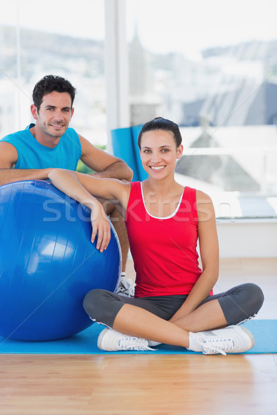 Instructor and smiling woman with exercise ball at gym Stock photo © wavebreak_media