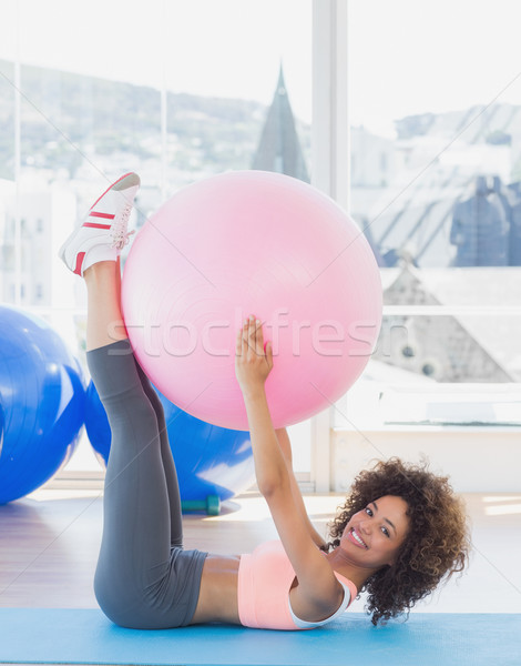 Sporty young woman with exercise ball in fitness studio Stock photo © wavebreak_media