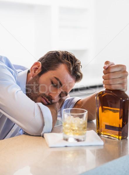 Részeg üzletember whiskey üveg alszik helyi Stock fotó © wavebreak_media