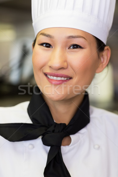 Closeup of a female cook in kitchen Stock photo © wavebreak_media