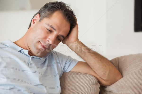 Close-up of a thoughtful man sitting on sofa Stock photo © wavebreak_media
