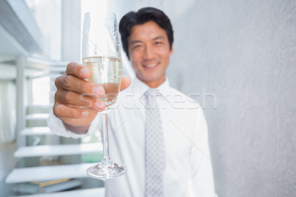 Happy man holding flute of champagne Stock photo © wavebreak_media