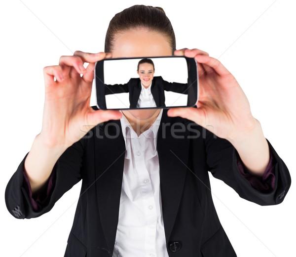 Businesswoman taking a selfie on smartphone Stock photo © wavebreak_media