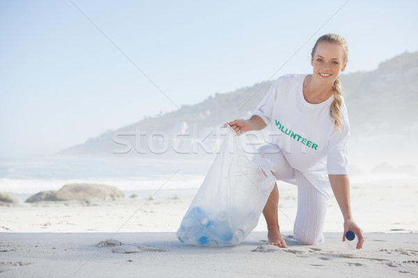 Militant up trash plage Photo stock © wavebreak_media