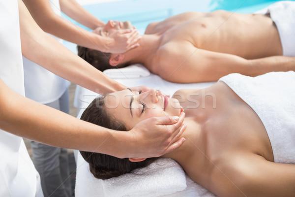 Content couple enjoying head massages poolside Stock photo © wavebreak_media