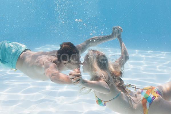 Sevimli çift öpüşme sualtı yüzme havuzu tatil Stok fotoğraf © wavebreak_media