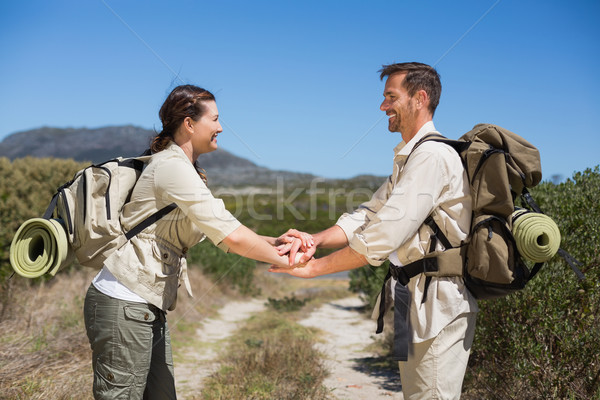 Hiking couple putting hands together on country trail Stock photo © wavebreak_media
