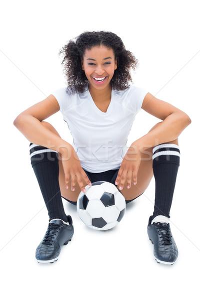 Csinos futballista fehér ül padló labda Stock fotó © wavebreak_media