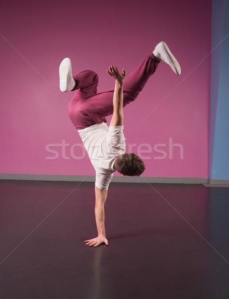 Cool break dancer doing handstand on one hand Stock photo © wavebreak_media