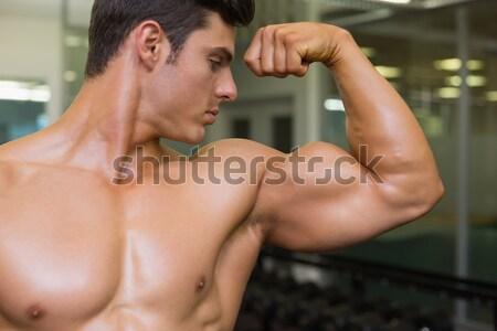Muscular man doing abdominal crunches in gym Stock photo © wavebreak_media