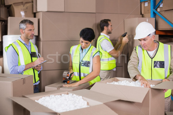 Warehouse workers in yellow vests preparing a shipment Stock photo © wavebreak_media