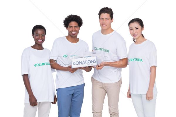 小さな 笑みを浮かべて ボランティア 寄付 白 ストックフォト © wavebreak_media