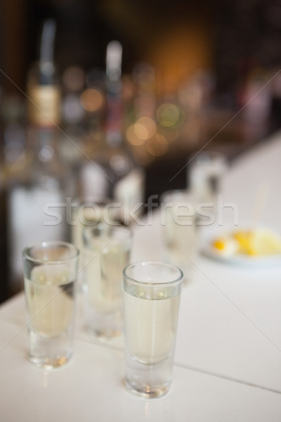 Close up of cocktail into shot glasses Stock photo © wavebreak_media