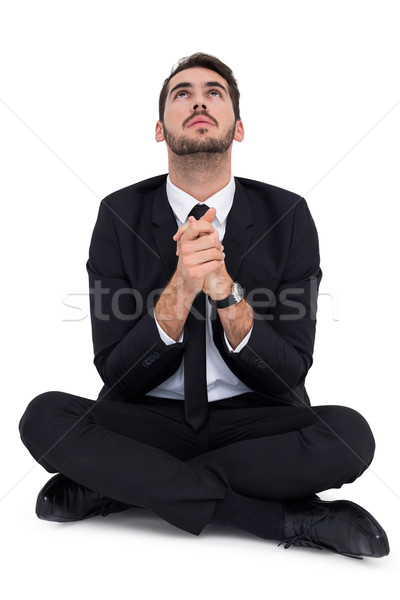 Businessman sitting praying and looking up Stock photo © wavebreak_media