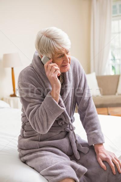 Senior man telefoongesprek bed home Stockfoto © wavebreak_media