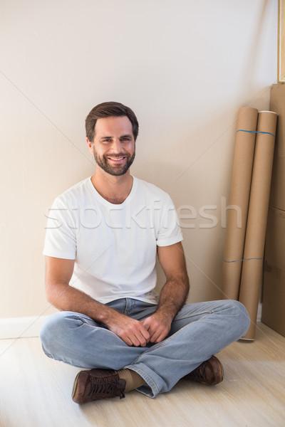 Boldog férfi ül padló új otthon otthon Stock fotó © wavebreak_media