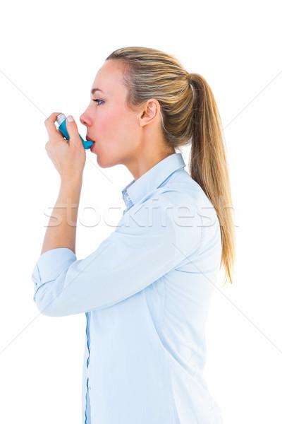 Beautiful blonde using an asthma inhaler Stock photo © wavebreak_media