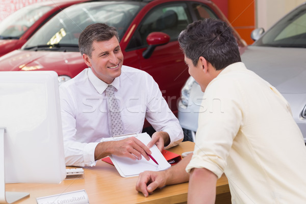 Salesman showing client where to sign the deal Stock photo © wavebreak_media